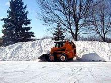 picture of bobcat managing snow aftr a snow storm