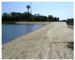 This photo shows Erosion control blanket stabilizes pond slopes.PNG