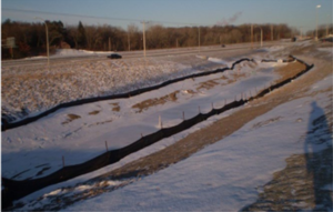 This photo shows Erosion control blanket stabilizes pond slopes